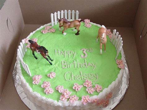 Breyer Stablemates horses frolic in a flowery buttercream